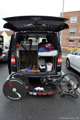 VW Van Transporter back view showing fitted bike wheel rack, bed and storage with Hand cycle on ground